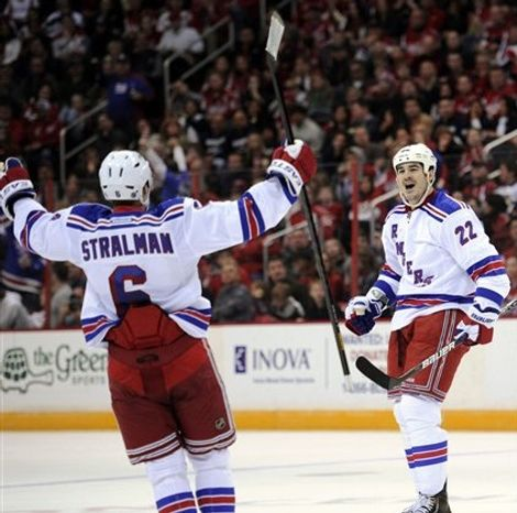 New York Rangers center Brian Boyle (22) celebrates his goal with Anton Stralman (6) during the second period of an NHL hockey game against the Washington Capitals, Sunday, March 10, 2013, in Washington. (AP Photo/Nick