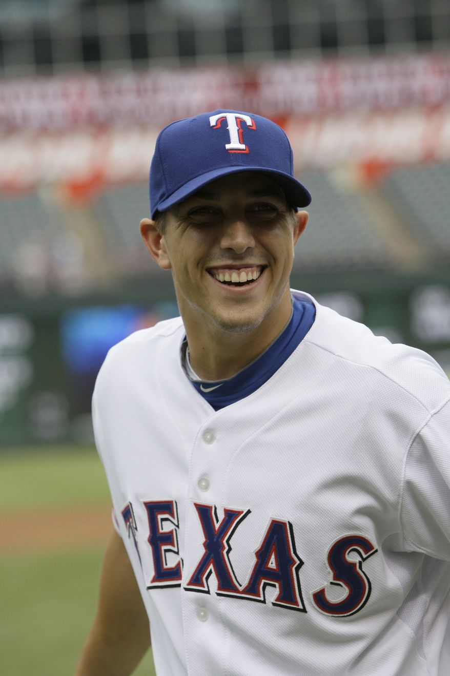 **FILE** The Texas Rangers first round draft pick Jake Skole smiles as he walks across the field Wednesday, June 9, 2010, in Arlington, Texas. The Rangers agreed to terms Wednesday with both of their first-round draft picks and assigned them to the Arizona League. Outfielder Skole was picked 15th overall in Monday nights draft. (AP Photo/Tony Gutierrez)