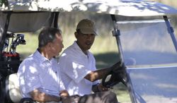 **FILE** New York City Mayor Michael Bloomberg (left) rides in a golf cart driven by President Obama while playing golf at Vineyard Golf Club, in Edgartown, Mass., on the island of Martha's Vineyard on Aug. 27, 2010. (Associated Press)
