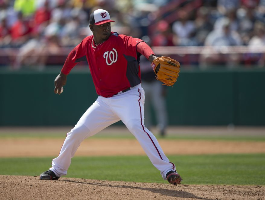 Washington Nationals pitcher Rafael Soriano delivers a pitch during the seventh inning of an exhibition spring training baseball game against the Atlanta Braves on Monday, March 11, 2013, in Viera, Fla. (AP Photo/Evan Vucci)