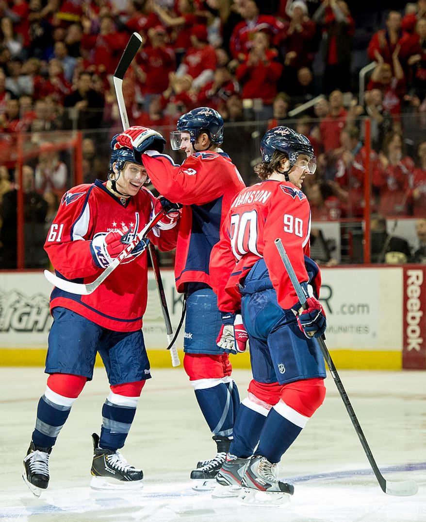 Washington Capitals defenseman Steven Oleksy (61) scores his first goal ever to put the Washington Capitals up 1-0 in the first period as they play the New York Rangers at the Verizon Center, Washington, D.C., Sunday, March 10, 2013. (Andrew Harnik/The Washington Times)
