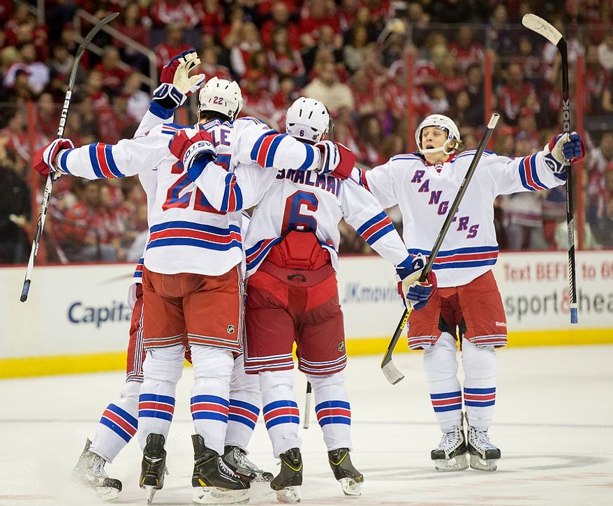 New York Rangers center Brian Boyle (22) celebrates a goal with teammates in the second period as the Washington Capitals play the New York Rangers at the Verizon Center, Washington, D.C., Sunday, March 10, 2013. (Andrew Harnik/The Washington Times)