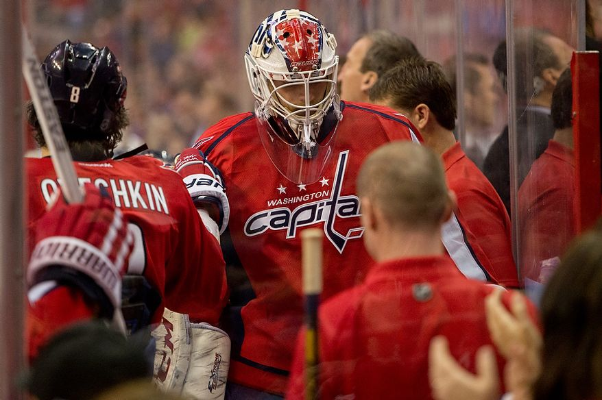 Washington Capitals goalie Michal Neuvirth (30), center, is pulled after giving up two goals in the second period as the Washington Capitals play the New York Rangers at the Verizon Center, Washington, D.C., Sunday, March 10, 2013. (Andrew Harnik/The Washington Times)