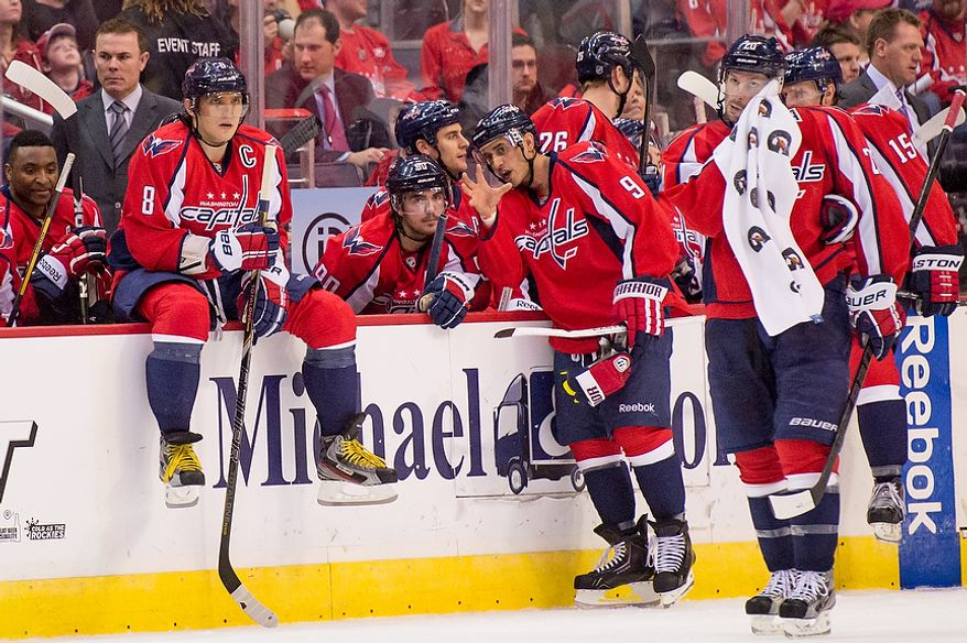 The Washington Capitals sit on the bench during a game stop in the third period as the Washington Capitals lose to the the New York Rangers 4-1 at the Verizon Center, Washington, D.C., Sunday, March 10, 2013. (Andrew Harnik/The Washington Times)