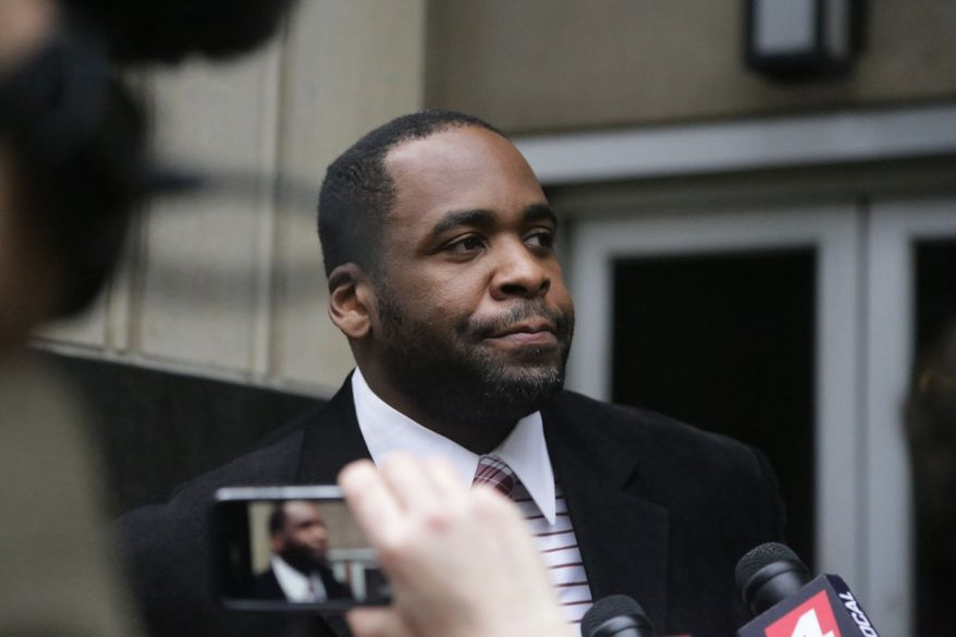 Former Detroit Mayor Kwame Kilpatrick leaves federal court in Detroit on Monday, March 11, 2013, after being convicted on corruption charges, ensuring a return to prison for a man once among the nation's youngest big-city leaders. (AP Photo/Detroit Free Press, Ryan Garza)
