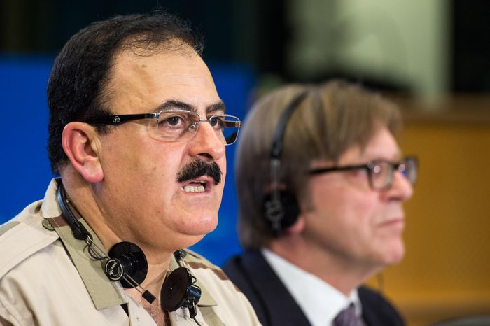 ** FILE ** Chief of Staff of the Free Syrian Army Gen. Salim Idris addresses the media after he discussed the situation in Syria with the leader of the Group of the Alliance of Liberals and Democrats for Europe Guy Verhofstadt, right, at the European Parliament in Brussels, Wednesday March 6, 2013. (AP Photo/Geert Vanden Wijngaert)