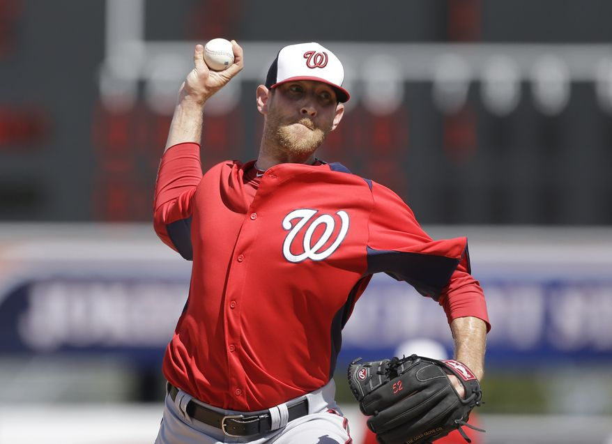 Washington Nationals relief pitcher Ryan Mattheus prepares to throw during the seventh inning of an exhibition spring training baseball game against the Detroit Tigers, Sunday, March 10, 2013 in Lakeland, Fla. (AP Photo/Carlos Osorio)