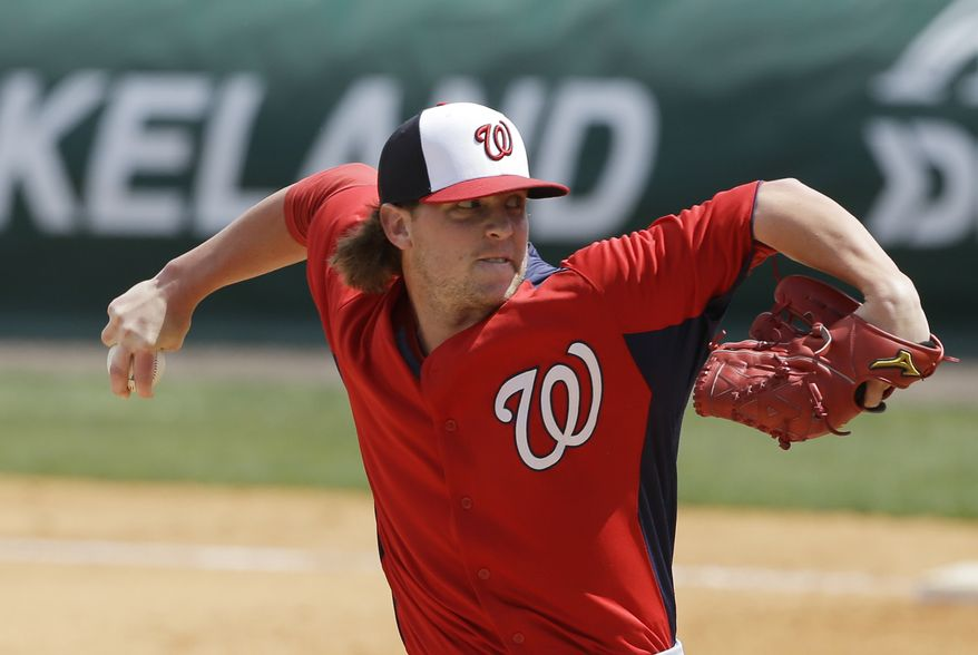 Washington Nationals relief pitcher Drew Storen pitches during the fifth inning of an exhibition spring training baseball game against the Detroit Tigers, Sunday, March 10, 2013 in Lakeland, Fla. (AP Photo/Carlos Osorio)