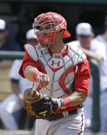 Washington Nationals catcher Wilson Ramos throws back the ball during the fifth inning of an exhibition spring training baseball game against the Detroit Tigers, Sunday, March 10, 2013 in Lakeland, Fla. (AP Photo/Carlos Osorio)