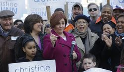 ** FILE ** Surrounded by family and supporters, New York City Council speaker and mayoral hopeful Christine Quinn, center, speaks to the media as she announces her mayoral run in New York, Sunday, March 10, 2013. The New York City Council speaker has formally launched what she hopes will be a history-making mayoral bid this fall. (AP Photo/Seth Wenig)