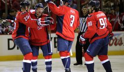 Washington Capitals defenseman Steven Oleksy, second from left, celebrate his goal with teammates Jason Chimera (25), Tom Poti (3) and Marcus Johansson (90), of Sweden, during the first period of an NHL hockey game, Sunday, March 10, 2013, in Washington. (AP Photo/Nick Wass)