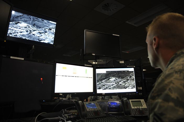 **FILE** An Air Force analyst monitors combat operations in Afghanistan from the operations center for the 497th Intelligence, Surveillance and Reconnaissance Group at Langley Air Force Base in Hampton, Va. (Associated Press/U.S. Ai
