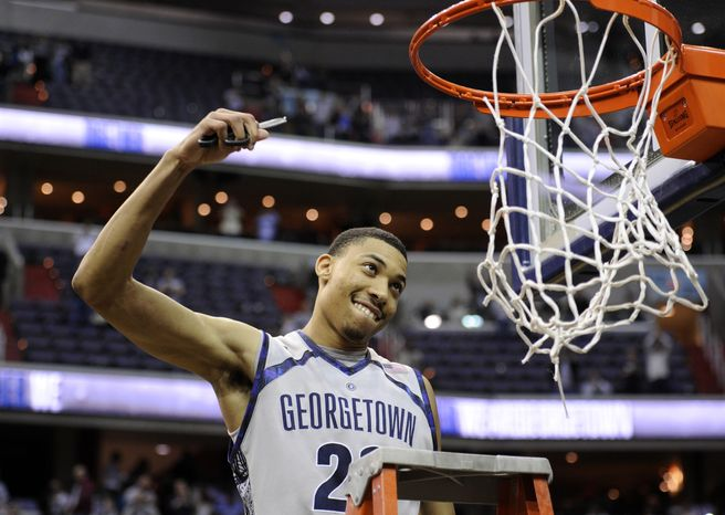 Georgetown forward Otto Porter Jr. (22) reacts as he climbs the ladder to cut the net after Georgetown beat Syracuse 61-39 in an NCAA college basketball game to win the Big East Conference regular-season title Saturday, March 9, 2013, in Washington. (AP Photo/Nick Wass)