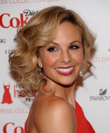 **FILE** Television personality Elisabeth Hasselbeck arrives at The Heart Truth's Red Dress Collection 2010 fashion show in New York on Feb. 11, 2010. (Associated Press)