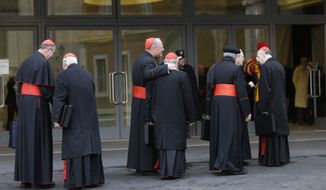 The princes of the Roman Catholic Church, including Cardinals Roger Mahony (left) and Timothy Dolan (third from left) of the United States, arrive for a meeting at the Vatican on Monday, March 11, 2013. The cardinals gathered for their final day of talks before the conclave to elect the next pope amid debate over whether the church needs a manager pope to clean up the Vatican's messy bureaucracy or a pastoral pope who can inspire the faithful and make Catholicism relevant again. (AP Photo/Alessandra Tarantino)