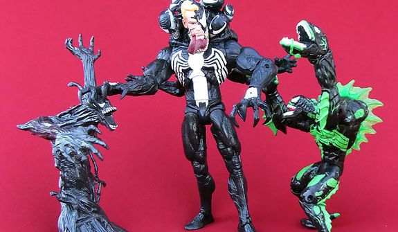 Marvel Select Venom from Diamond Select Toys (center) stands next to the 1997 Web SplashersÕ Black Sea Venom from Toy Biz  and the  Venom Symbiote from HasbroÕs classic Spider-Man 3 collection. (Photograph by Joseph Szadkowski / The Washington Times)
