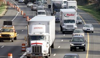 **FILE** Traffic on Interstate 95 near the Capital Beltway exit in Beltsville, Md. (Associated Press)