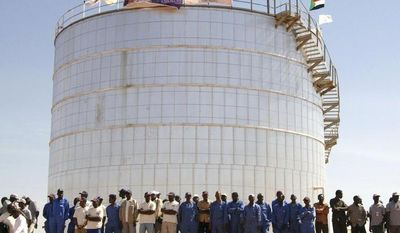 Workers and others attend an inauguration of an oil facility by Sudan Vice President Ali Osman Mohamed Taha in South Kordofan, Sudan, on Dec. 20, 2012. (Associated Press)