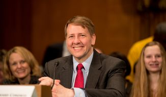 Richard Cordray, President Obama's pick to head the Consumer Financial Protection Bureau, testifies March 12, 2013, at his confirmation hearing in front of the U.S. Senate Banking, Housing and Urban Affairs Committee on Capitol Hill. (Andrew Harnik/The Washington Times)
