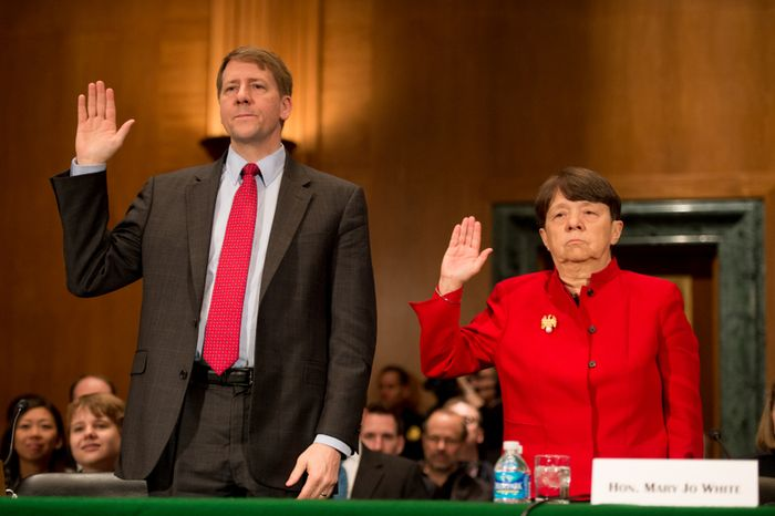 Richard Cordray and Mary Jo White are sworn in March 12, 2013, before testifying in front of the U.S. Senate Banking, Housing and Urban Affairs Committee on Capitol Hill for their confirmation hearings. Cordray and White are President Obama's picks to head the Consumer Financial Protection Bureau and the Secu