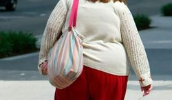 America's weight problem is proving a much heftier drag on the economy than previously thought. (Associated Press)