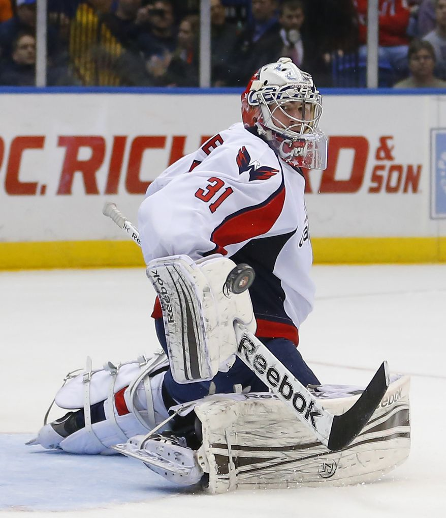 Washington Capitals goalie Philipp Grubauer (31) makes a save in an NHL hockey game against the New York Islanders at the Nassau Coliseum in Uniondale, N.Y., Saturday, March 9, 2013. (AP Photo/Paul J. Bereswill)