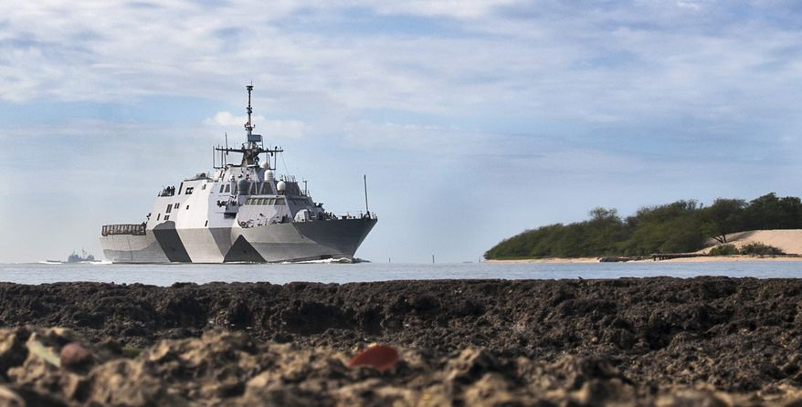 In this photo provided by the U.S. Navy, the USS Freedom littoral combat ship pulls into Pearl Harbor, Hawaii. The USS Freedom, which is stopping in Hawaii on its way to a deployment to Singapore, has advantages bigger U.S. Navy ships lack. (AP Photo/US Navy, Mass Communication Specialist 2nd Class Sean Furey)