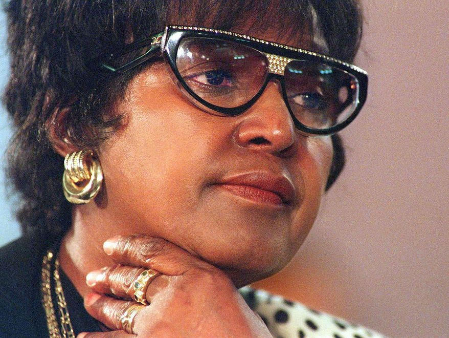 ** FILE ** Winnie Madikizela-Mandela listens to evidence at a Truth and Reconciliation Commission hearing in Johannesburg in 1997. (AP Photo/Odd Anderson, Pool)