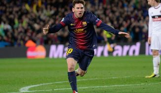 Barcelona's forward Lionel Messi, from Argentina, celebrates after scoring their second goal during the Champions League round of 16 second leg soccer match between FC Barcelona and AC Milan at Camp Nou stadium, in Barcelona, Spain, Tuesday, March 12, 2013. (AP Photo/Manu Fernandez)