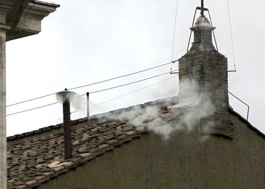** FILE ** White smoke billows from the chimney atop the Sistine Chapel at the Vatican on April 19, 2005, to announce the election of Cardinal Joseph Ratzinger of Germany as Pope Benedict XVI. (AP Photo/Pier Paolo Cito)