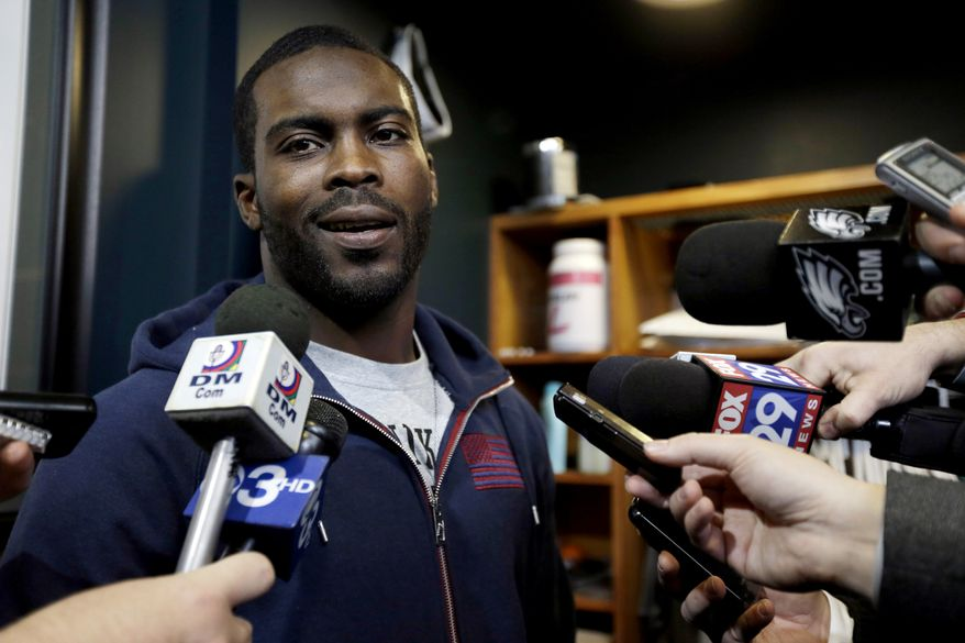 ** FILE ** In this Dec. 31, 2012, file photo, Philadelphia Eagles quarterback Michael Vick speaks to members of the media as he cleans out his locker at the team's NFL football training facility in Philadelphia. Vick's book-signing tour has been canceled because of threats against him for running a dogfighting ring. (AP Photo/Matt Rourke, File)