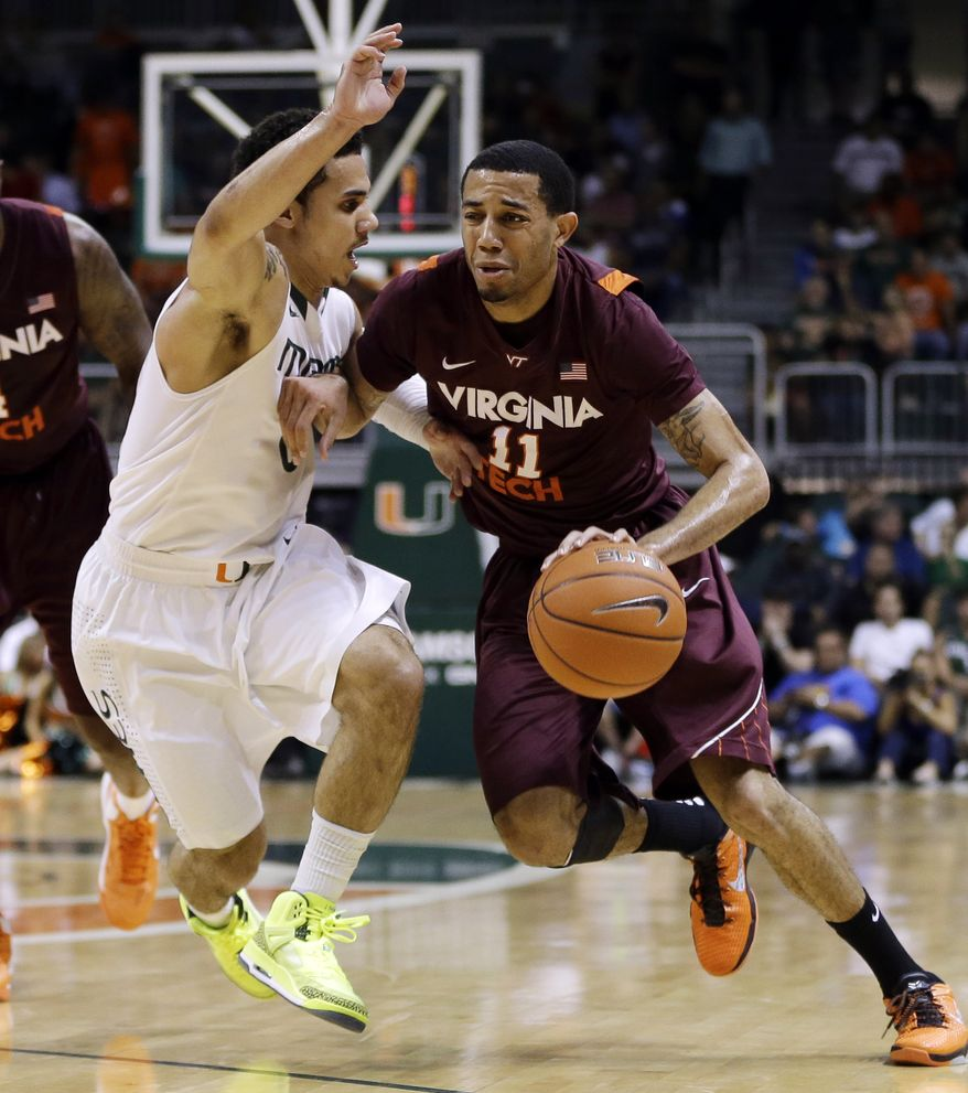 **FILE** Miami's Shane Larkin (0) tries to steal the ball from Virginia Tech's Erick Green (11) during the first half of an NCAA college basketball game in Coral Gables, Fla., Wednesday, Feb. 27, 2013. (AP Photo/J Pat Carter)