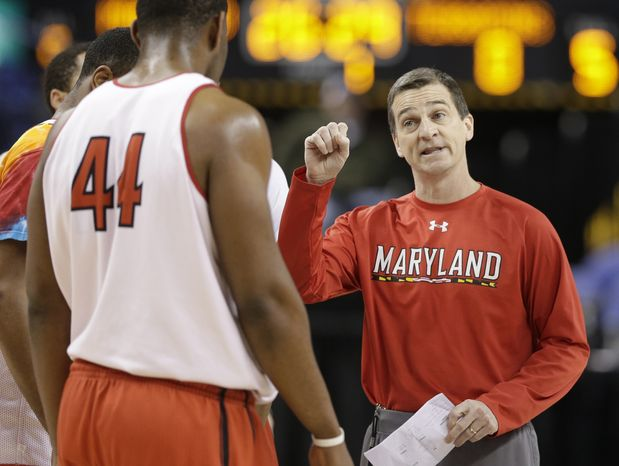 Maryland head coach Mark Turgeon, right, talks with Shaquille Cleare, left, during NCAA college basketball practice at the Atlantic Coast Conference tournament in Greensboro, N.C., Wednesday, March 13, 2013. Maryland plays Wake Forest on Thursday. (AP Photo/Chuck Burton)