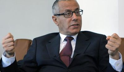 **FILE** Ali Zeidan, a Europe-based envoy for the Libyan National Transitional Council, speaks to the Associated Press in Paris on March, 21, 2011. (Associated Press)