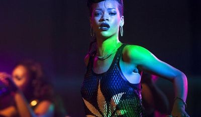 """** FILE ** Barbadian singer Rihanna performs during the fifth stop of her """"777"""" worldwide tour at the E-Werk club in Berlin on Monday, Nov. 19, 2012. (AP Photo/Markus Schreiber)"""