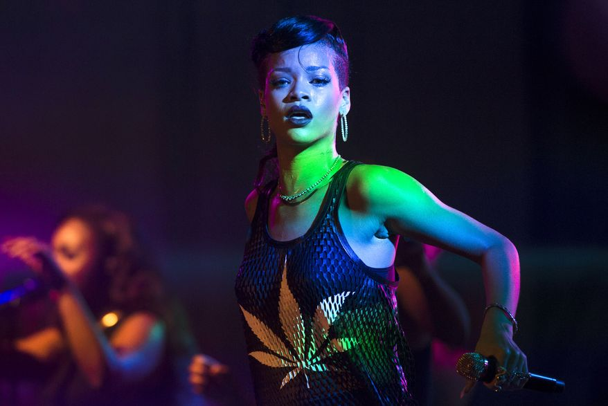 "** FILE ** Barbadian singer Rihanna performs during the fifth stop of her ""777"" worldwide tour at the E-Werk club in Berlin on Monday, Nov. 19, 2012. (AP Photo/Markus Schreiber)"