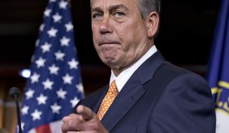** FILE ** House Speaker John Boehner, Ohio Republican, speaks to reporters on Capitol Hill in Washington on March 13, 2013, following a closed-door meeting with President Obama and House Republicans to discuss the budget. (Associated Press)