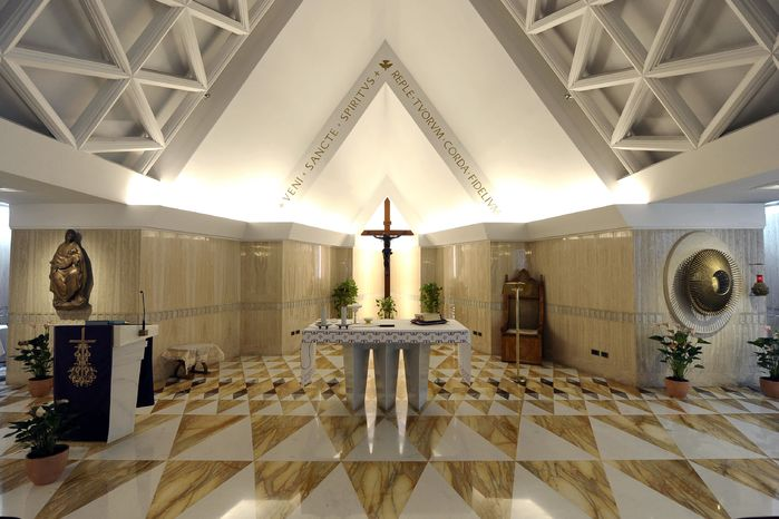 This photo provided by the Vatican newspaper L'Osservatore Romano Saturday, March 9, 2013, shows the chapel of Vatican's Santa Marta hotel where the cardinals were sequestered once the conclave began. (AP Photo/L'Osservatore Romano, ho)