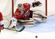 Carolina Hurricanes goalie Dan Ellis guards the goal against the New Jersey Devils during the third period of the Hurricanes' 6-3 win in Raleigh, N.C., on March 9, 2013. (Associated Press)