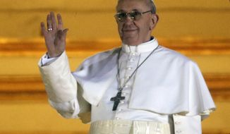 Pope Francis waves to the crowd from the central balcony of St. Peter's Basilica at the Vatican, Wednesday, March 13, 2013. Cardinal Jorge Bergoglio, who chose the name of Francis, is the 266th pontiff of the Roman Catholic Church. (AP Photo/Gregorio Borgia)
