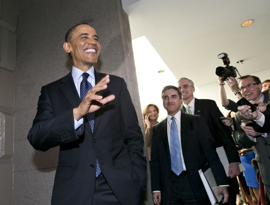 President Obama turns to reporters as he leaves Capitol Hill in Washington on Wednesday, March 13, 2013, after his closed-door meeting with House Republicans to discuss the budget. (AP Photo/J. Scott Applewhite)