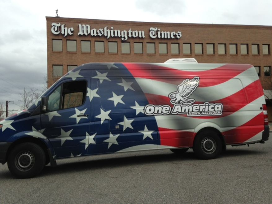 The One America News Network van in front of the Washington Times office in Washington.