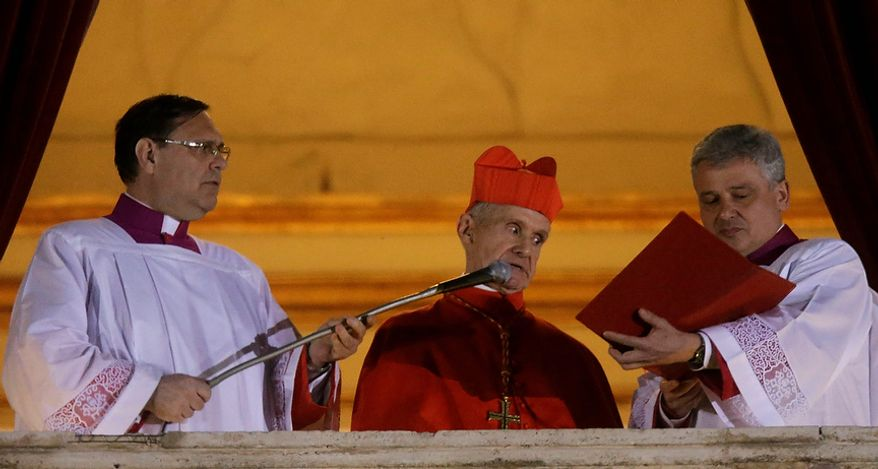 Cardinal Jean-Louis Tauran, center, announces the newly elected pope from the central balcony of St. Peter's Basilica at the Vatican, Wednesday, March 13, 2013. Argentine Cardinal Jorge Bergoglio has been elected pope, the first pontiff from Americas. (AP Photo/Gregorio Borgia)