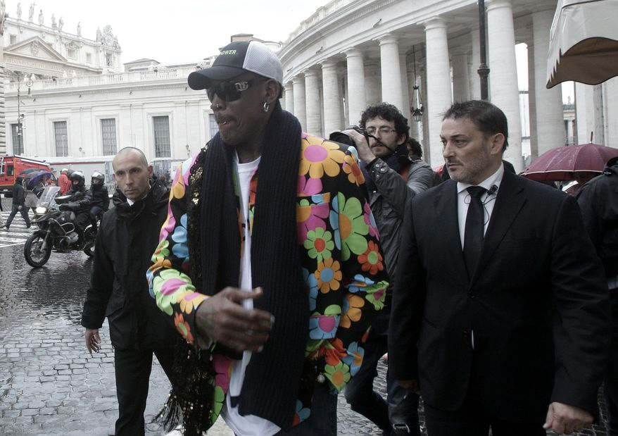 Former NBA star Dennis Rodman walks by the Bernini Colonnade near St. Peter's Square at the Vatican, Wednesday, March 13, 2013. Rodman is in Rome to promote the papal candidacy of Cardinal Peter Turkson of Ghana. ((AP Photo/Riccardo De Luca)