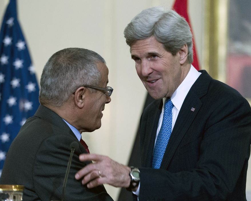 Secretary of State John F. Kerry (right) talks with Libyan Prime Minister Ali Zeidan at the State Department in Washington on Wednesday, March 13, 2013. (AP Photo/Jose Luis Magana)