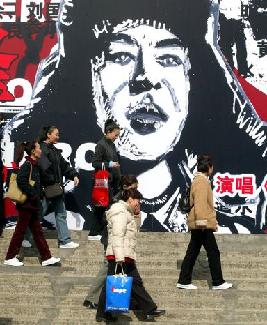 Lei Feng, a half-real, half-fabricated man depicted by the Chinese government as the communist model soldier, has become a political icon. (Associated Press)