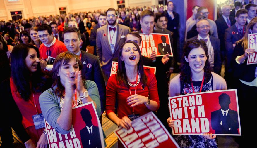 Supporters of Sen. Rand Paul, Kentucky Republican, listen to his CPAC speech. He drew cheers from young voters who see him as a libertarian hero. (Andrew Harnik/The Washington Times)