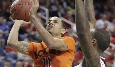 Virginia Tech's Erick Green (11) drives past North Carolina State's Richard Howell during the second half of an NCAA college basketball game at the Atlantic Coast Conference tournament in Greensboro, N.C., Thursday, March 14, 2013. (AP Photo/Bob Leverone)