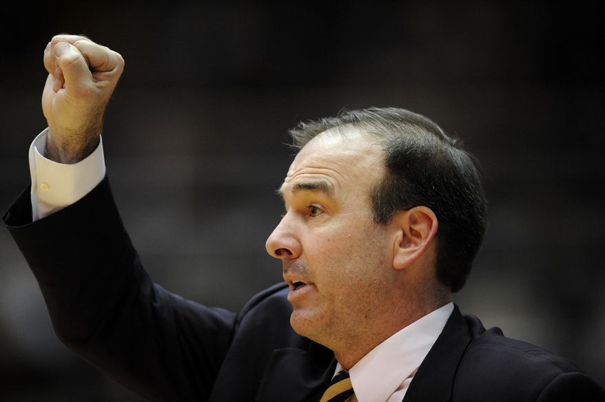 **FILE** George Washington head coach Mike Lonergan gestures during the second half of an NCAA college basketball game against Butler, Saturday, Feb. 9, 2013, in Washington. Butler won 59-56. (AP Photo/Nick Wass)