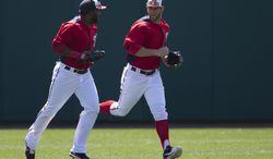Washington Nationals outfielders Denard Span, left, and Bryce Harper run to the dugout during the fourth inning of an exhibition spring training baseball game against the Houston Astros on Thursday, March 14, 2013, in Viera, Fla. (AP Photo/Evan Vucci)